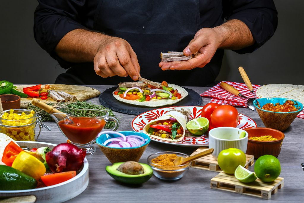 chef making tortilla. Mexican cuisine snacks, cooking fast food for commercial kitchen